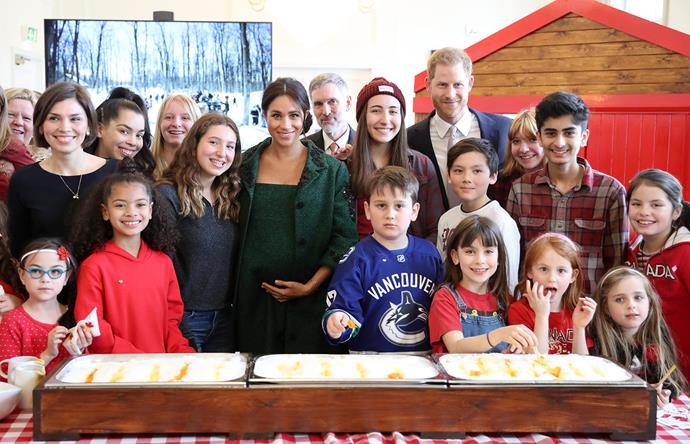 Meghan and Harry joined young Canadians last year to make maple taffy on Commonwealth Day. *(Image: Getty)*