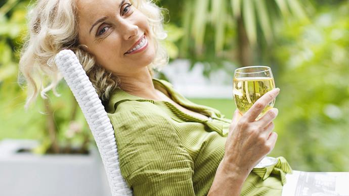 Woman relaxing drinking wine