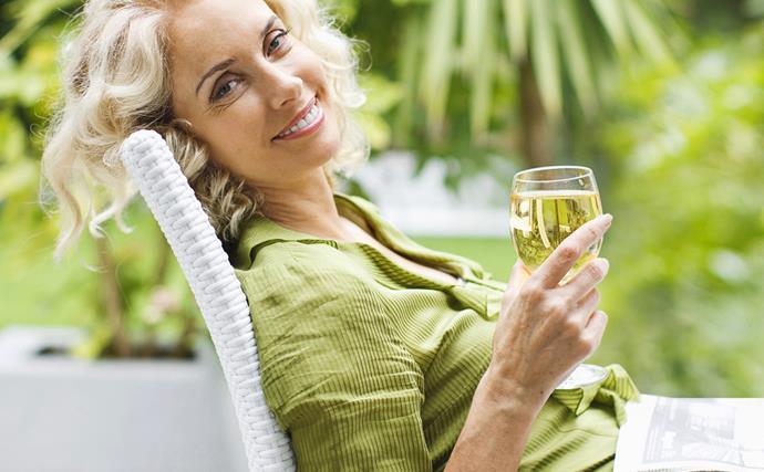 Woman relaxing drinking wine