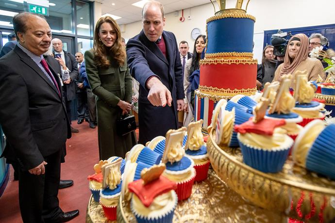 William and Catherine take a closer look at the incredible cake and cupcakes documenting their milestones. *(Image: Getty)*