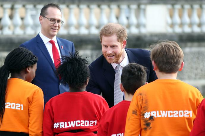 Prince Harry meets local school children at Buckingham Palace. *(Image: Getty)*