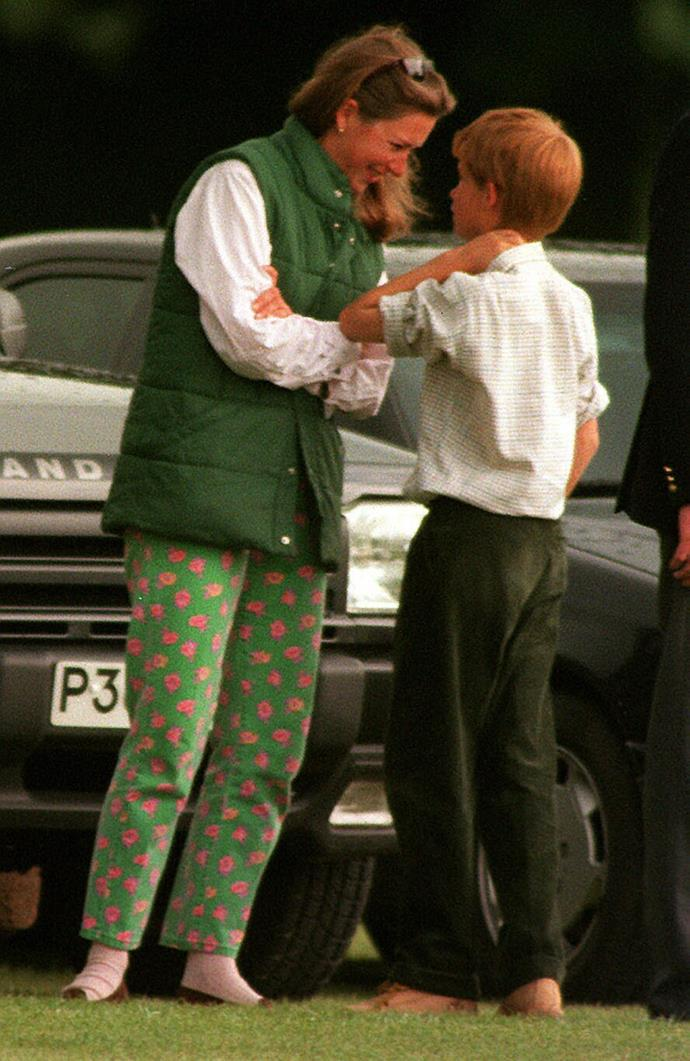 A young Prince Harry chats with his nanny Tiggy Legge-Bourke at the Cirencester Polo Club in 1997. *(Image: Getty)*