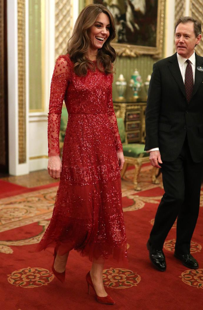 Catherine looked breathtaking in red at Monday evening's reception. *(Image: Getty)*