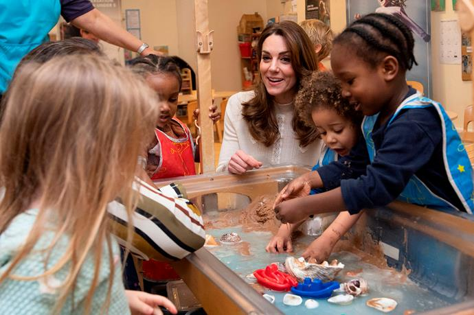Catherine played with the preschoolers who were enjoying the shells, sand and water. *(Image: Getty)*