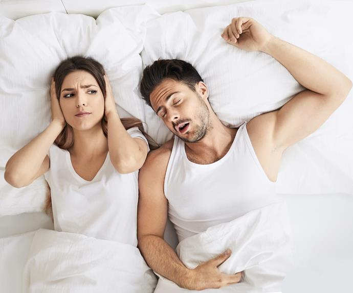 Couple in bed, man snoring woman wide awake