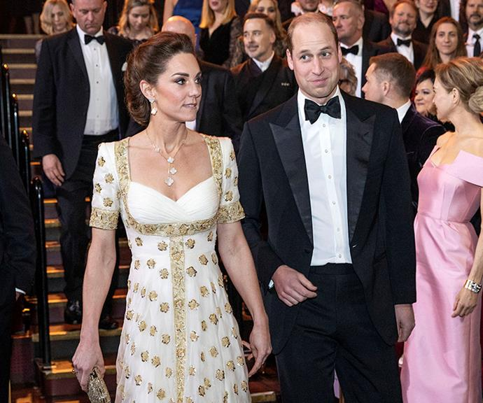 Kate accessorised with gold Jimmy Choo heels and a matching clutch and Van Cleef and Arpels earrings and necklace. *(Image: Getty)*