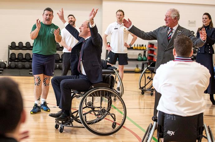 Sixth time lucky! Prince William finally makes the shot, after a little help from his father. *(Image: Getty)*