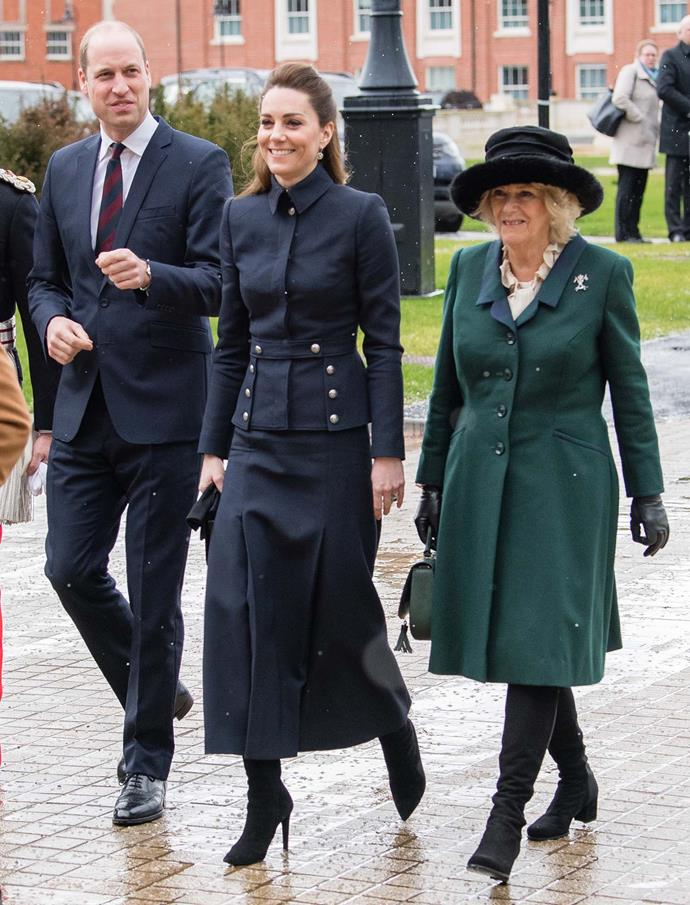Duchess Catherine wore an outfit by Alexander McQueen while Duchess Camilla opted for a three-piece outfit by Mr Roy. *(Image: Getty)*