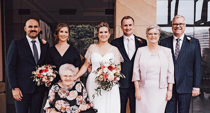 Helen and husband Stephen (right) with their family on daughter Hannah's wedding day last year.