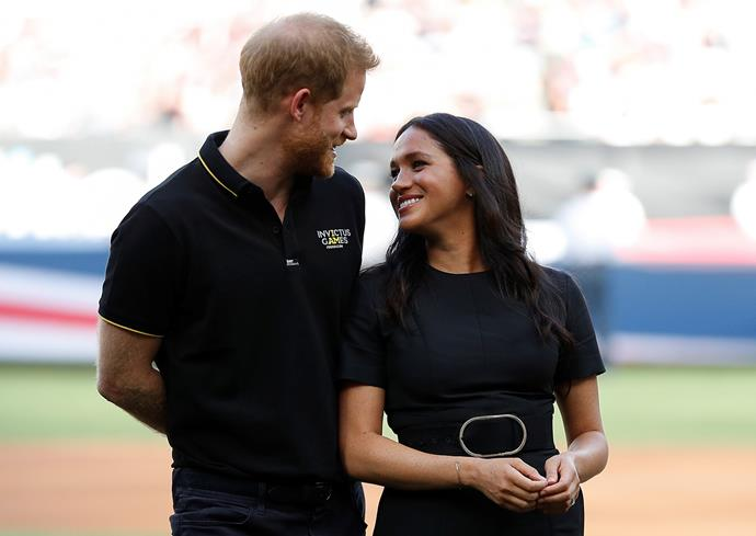 Harry and Meghan are thought to be completing the transition to no longer be working royals next month. *(Image: Getty)*