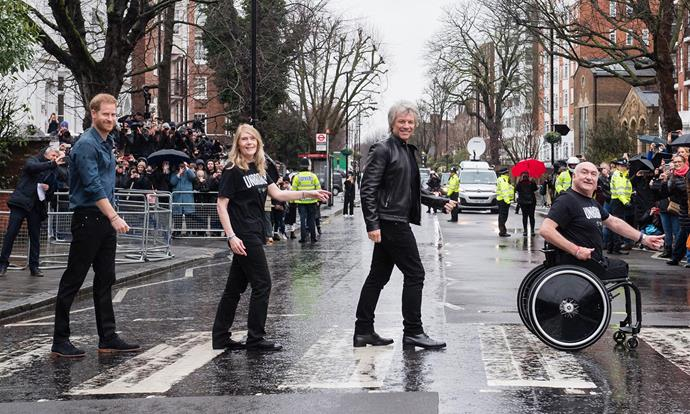 Prince Harry and Bon Jovi recreated The Beatles' *Abbey Road* album cover with the help of members from the Invictus Choir. *(Image: Getty)*