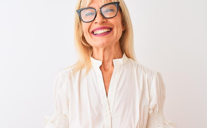 mature woman smiling wearing glasses