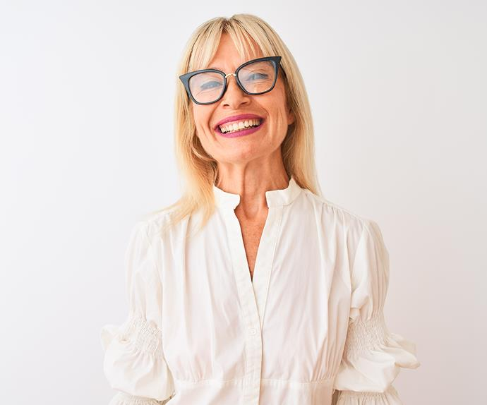 mature woman smiling wearing glasses