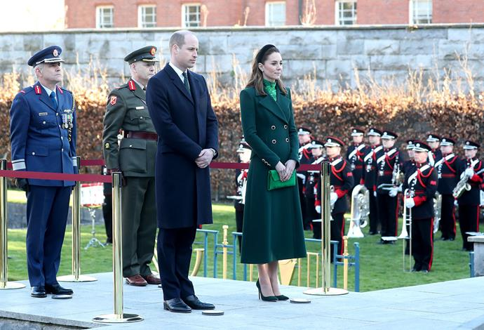 The royal couple laid a wreath and paid their respects at the Garden of Remembrance. *(Image: Getty)*
