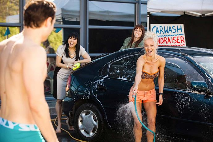 At the *Shortland Street* carwash! Wet and wild with Grace (Lynette Forday, left) and Harper (Ria Vandervis).
