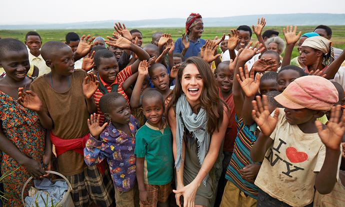 Meghan (above, in Rwanda in 2016) could follow the lead set by Angelina Jolie and combine philanthropic work with endorsements to achieve financial independence.