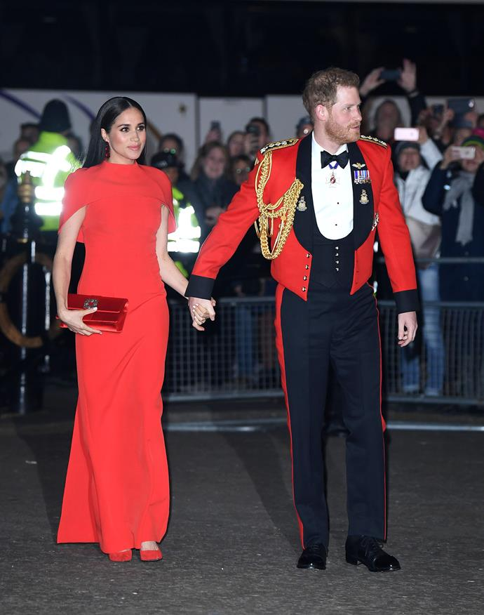 Meghan and Harry looked incredible in their matching red attire. *(Image: Getty)*
