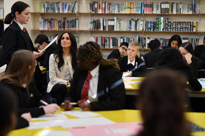 Meghan spoke to high schoolers at Robert Clack School about what International Women's Day means to them. *(Image: Getty)*