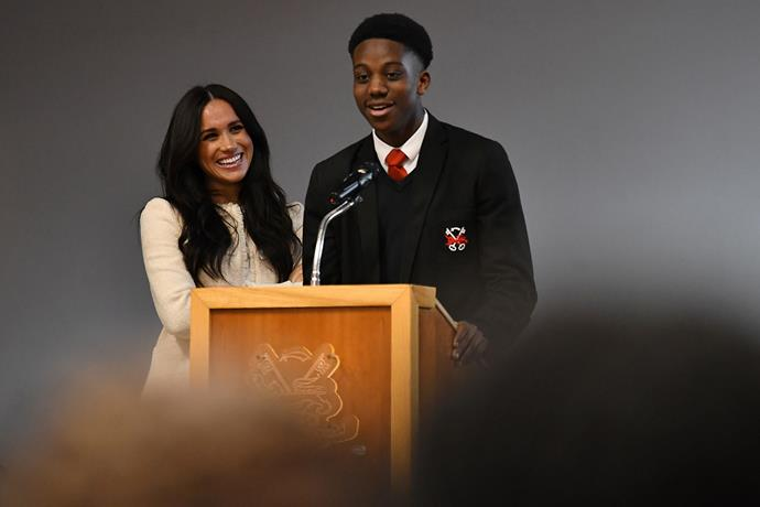 Head Boy Aker Okoye makes the crowd and the duchess laugh during her visit to Robert Clack Upper School in Essex. *(Image: Getty)*