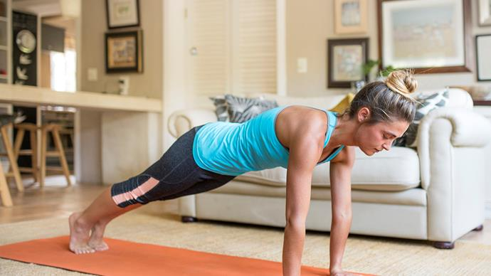 woman doing a plank at home