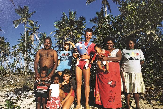 Baby Emma in New Caledonia with sailor dad Ross, her mum and friendly locals.