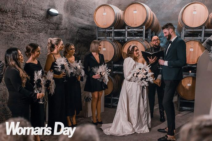 With a glass of Champagne in hand, the couple's unique ceremony took place in an historic wine cave in Queenstown
