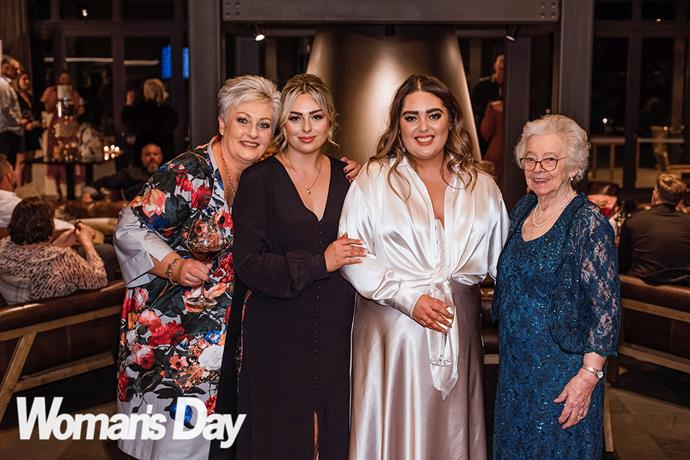 Donning her second stunning wedding outfit, Bailee shares a moment with (from left) mum Karen, sister Jaz and nana Jean.