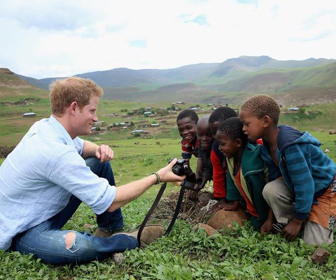 Prince Harry with children supported through Sentebale in 2014. (Getty)