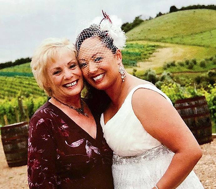 On her wedding day with her late mum Diane;