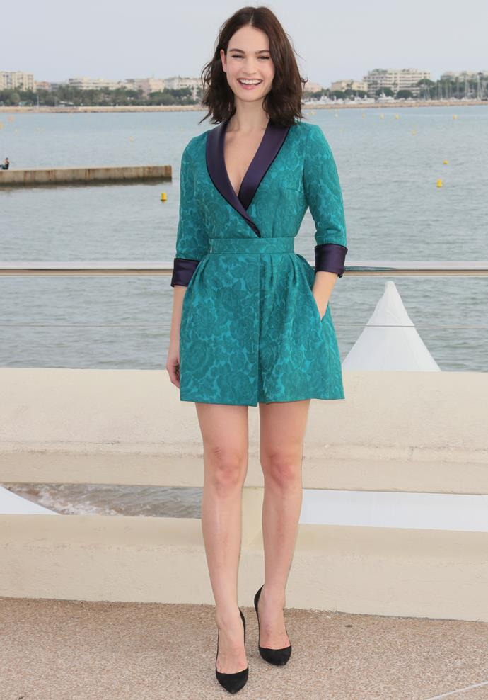 Lily James in Ulyana Sergeenko at the Cannes photo call for *War and Peace*