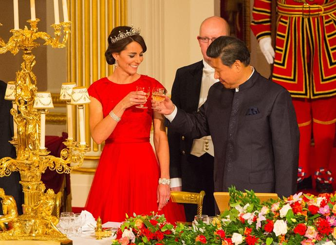Kate wore a regal red Jenny Packham gown for the occasion.