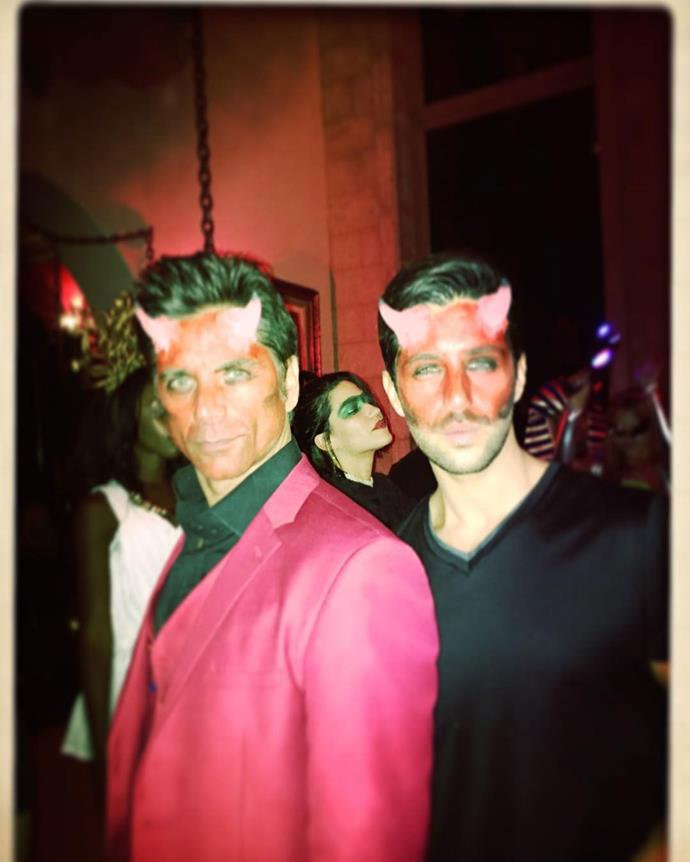 *Grandfathered* co-stars John Stamos and Josh Peck went as matching red devils for a Halloween bash.