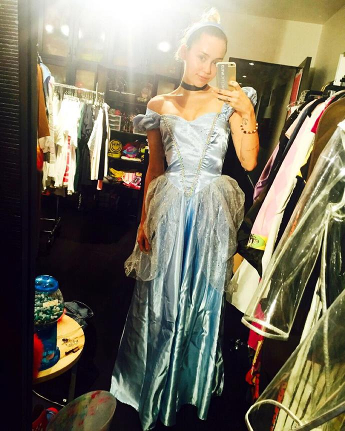 After modelling her outfit on Lil' Kim in 2013, Miley seems to be going back to her Disney roots this year with a Cinderella costume.