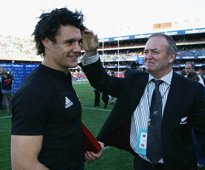 **August 2006**: Dan gets a congratulatory pat on the head from coach Graham Henry after the All Blacks' victory against South Africa in the Tri-Nations. Photo: Getty