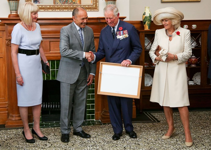 Lady Janine Mateparae and Camilla look on as Governor-General Sir Jerry Mateparae presents Charles with his new Military Warrants. Photo: Getty