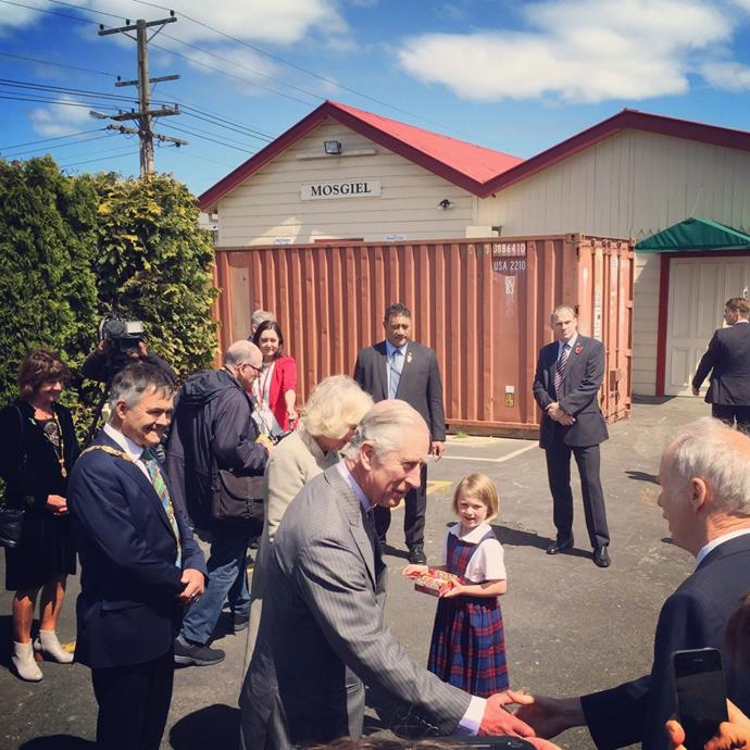 Charles and Camilla greet their welcoming party at Mosgiel Station. Photo: Twitter