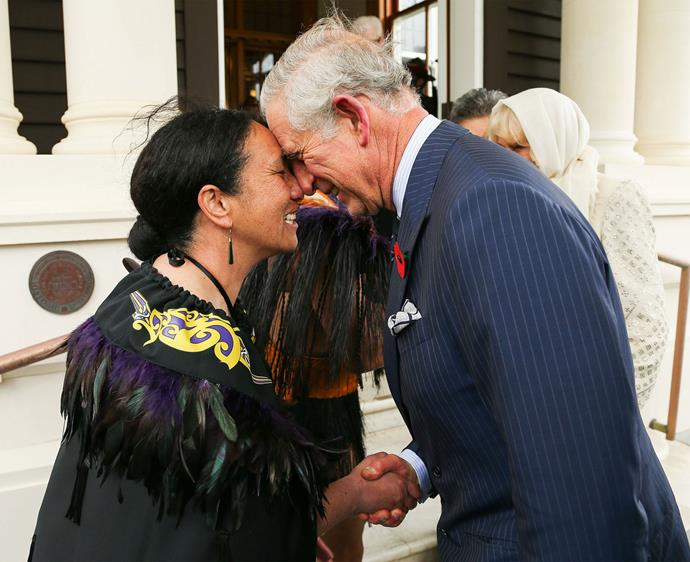 Charles is welcomed with a hongi from New Zealand Defence Force Flight Sergeant Wai Paenga during a ceremony at Wellington's Government House. Photo: Getty