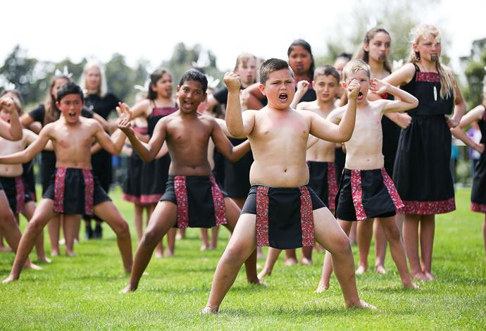 Children perform a haka for the pair during the 'Tea with Taranaki' event at Brooklands Park. Photo: Getty