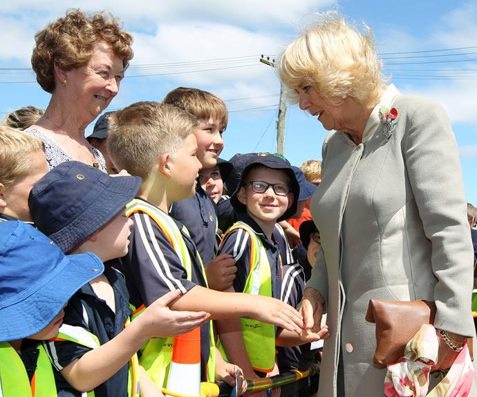 Camilla shakes hands with young royal fans at Mosgiel Railway Station. Photo: Getty