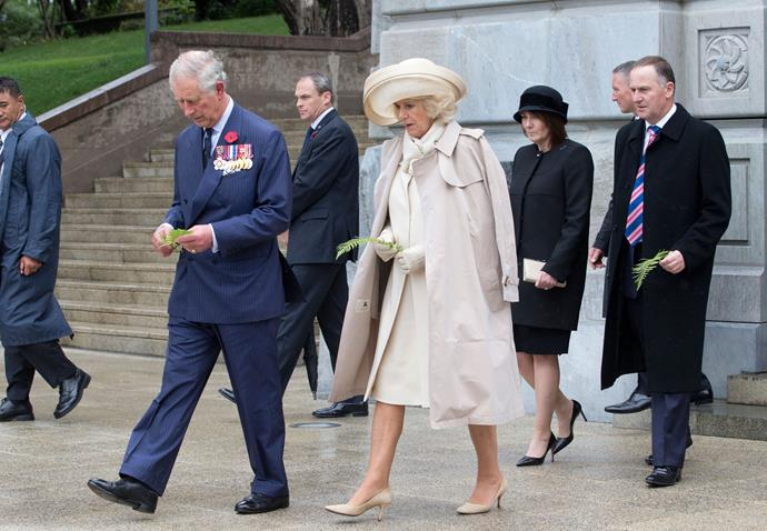 Charles and Camilla (with Prime Minister John Key and his wife Bronagh) lay ferns on the Tomb of the Unknown Warrior in Wellington. Photo: Getty