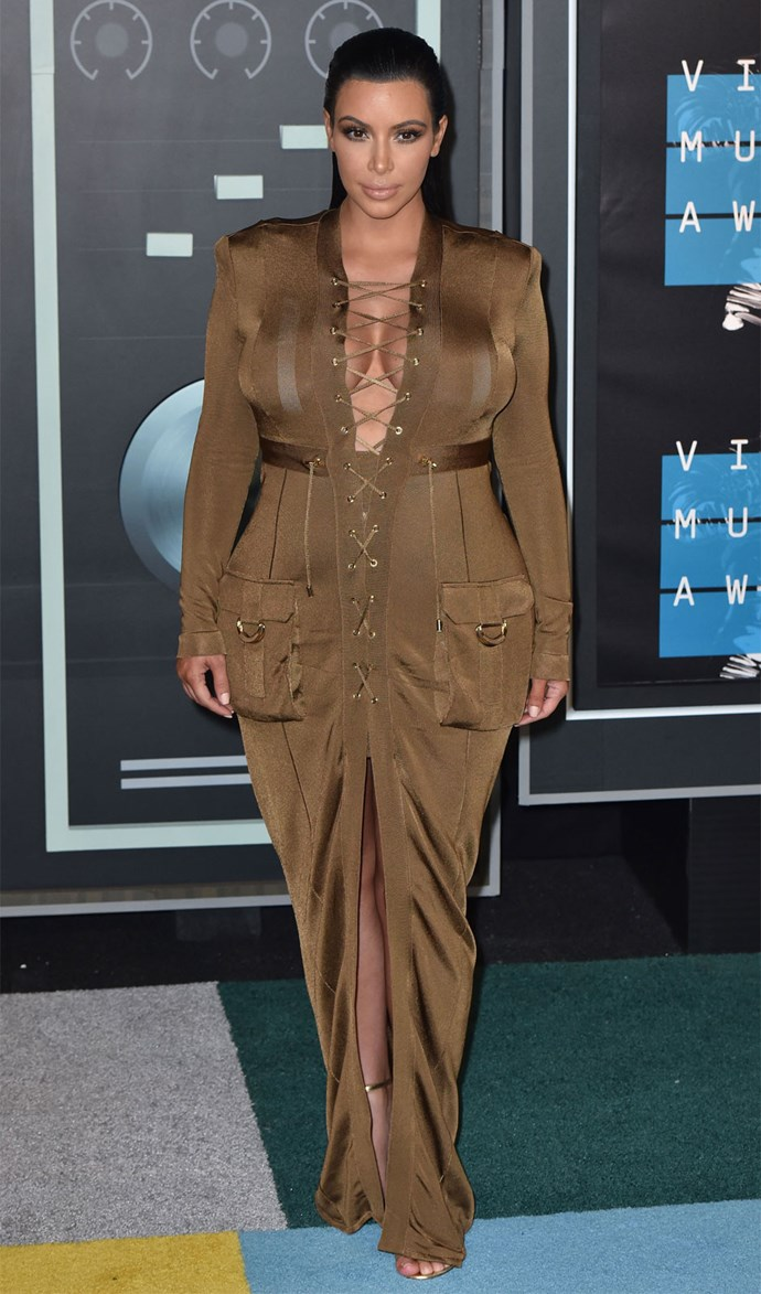 **August 30:** Kim steps out at the 2015 Video Music Awards in a floor-length brown dress that showed off plenty cleavage and a hint of legs. Photo: Getty