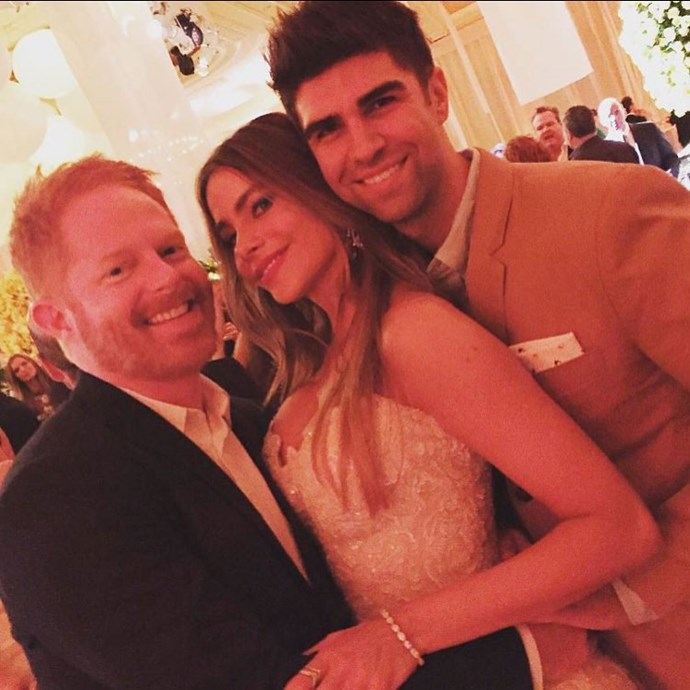 Sofia gets a cuddle from her co-star Jesse Tyler Ferguson and his husband Justin Mikita. Photo: Instagram