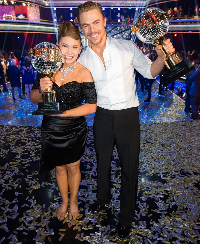Bindi and Derek hold on tight to their trophies after their big win. Photo: Getty