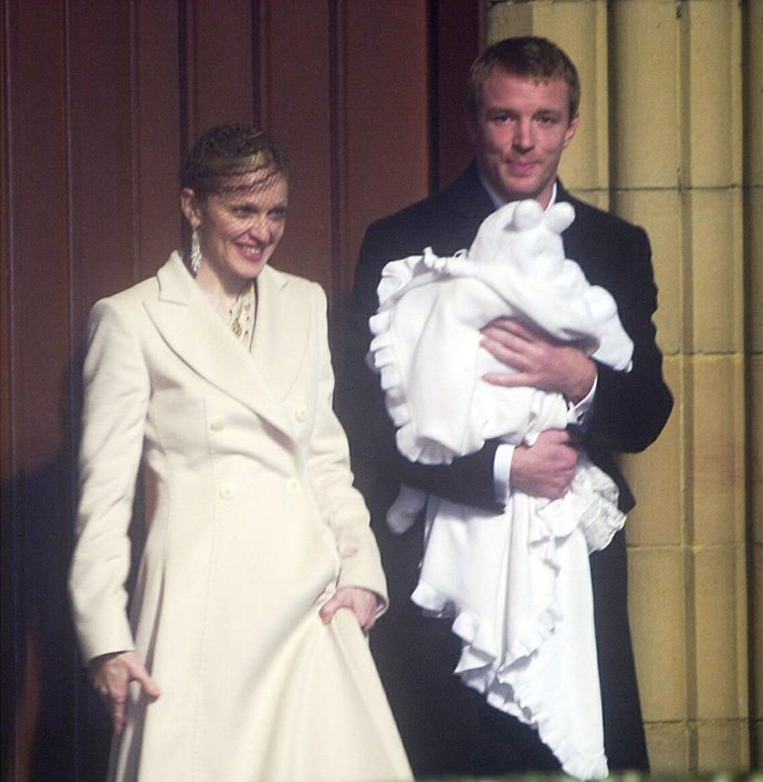 Madonna and Guy Ritchie with Rocco at his baptism in 2000. Photo: Getty