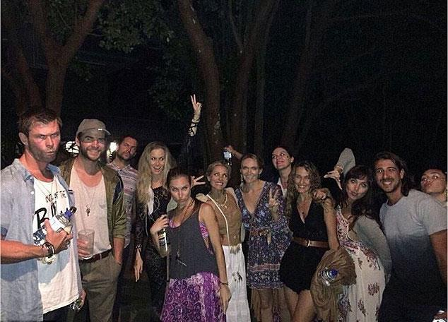 Liam (second from left) and Miley (far right) were spotted at a music festival in Byron Bay. Photo: Instagram