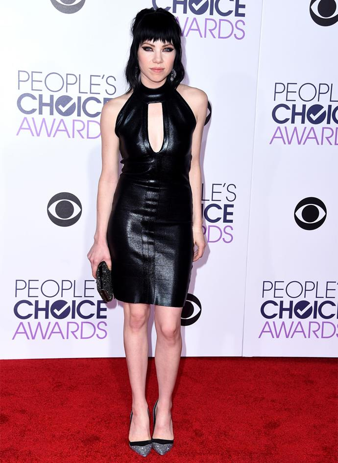 Carly Rae Jepsen vamped it up in a black leather mini-dress. Photo: Getty