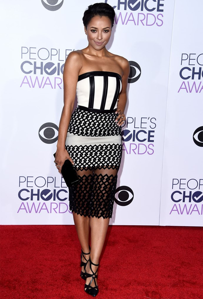 *The Vampire Diaries* star Kat Graham stood out in a black, white and sheer strapless dress. Photo: Getty
