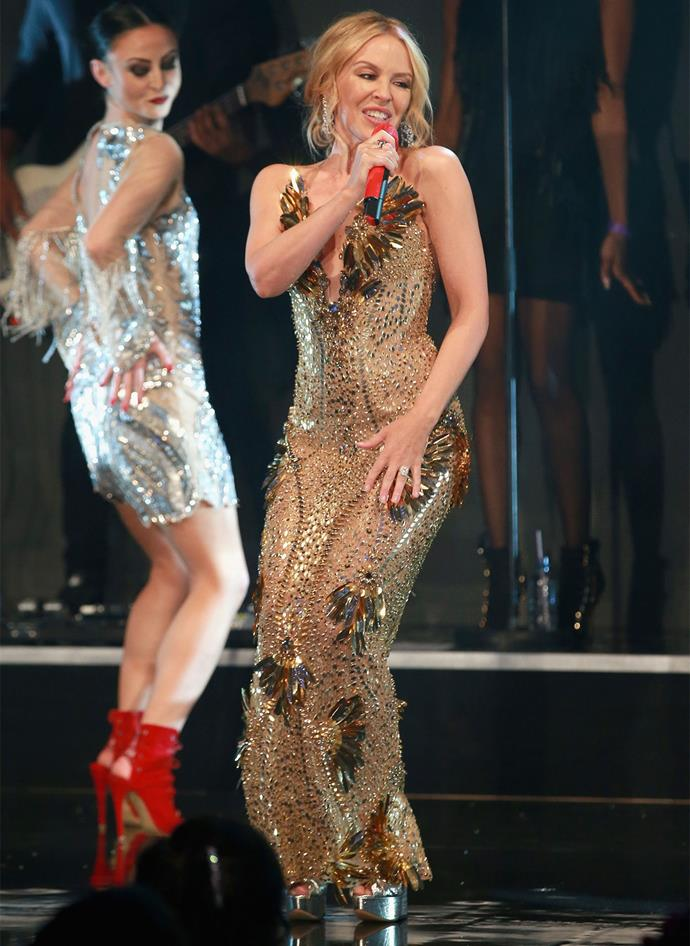 Kylie performed at the charity event wearing a glittering ring on her left hand. Photo: Getty
