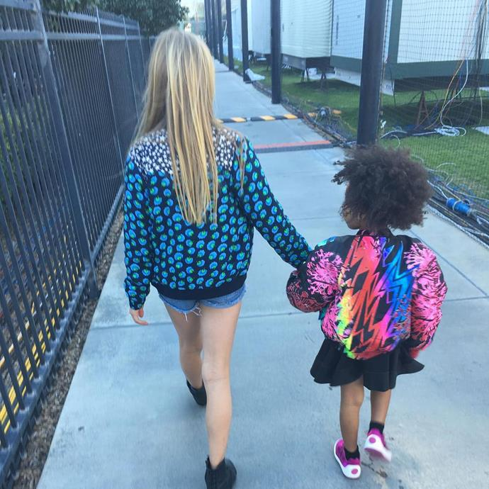 """Blue and Apple Martin (Chris' eldest daughter) hold hands. Proud mum Gwyneth shred this snap with the caption: """"#superbowl50 jacket game"""""""
