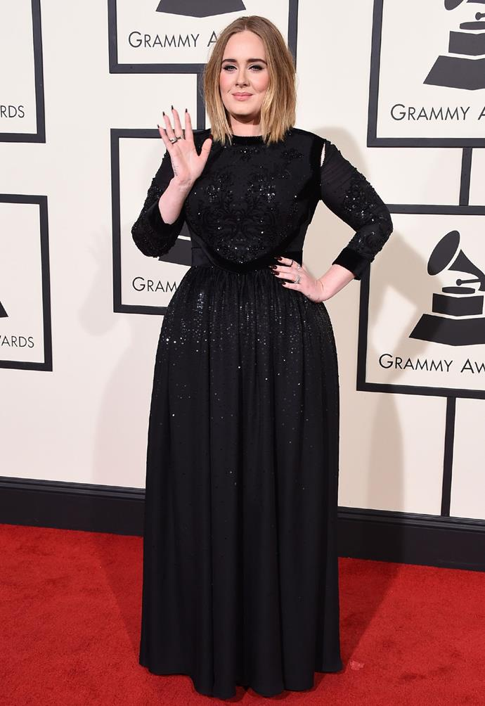 Meanwhile, Adele - looking gorgeous in a sparkling black gown on the big night - wowed the crowds with the first live performance of her song 'I'll Miss You' at a pre-Grammys party.